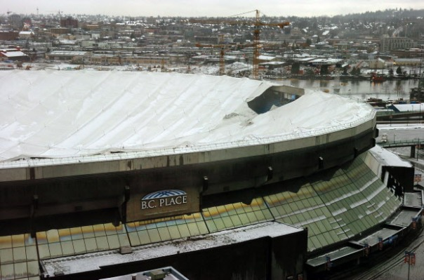 Vancouver-Jan 5, 2007-Roof of BC Place Stadium collapses Friday during a storm.  The one patch at right is the one that failed which sent the whole thing down.  Also, interior shot with workers and shot of General Manager of BC Place Howard Crosley talking to media. For Wency Leung story(Steve Bosch photo) [PNG Merlin Archive] *CALGARY HERALD MERLIN ARCHIVE*